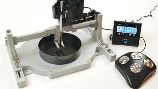 Sensapex manipulator mounted on Mobile HomeCage bridge